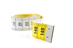 White and yellow measure tape in closeup Royalty Free Stock Photos