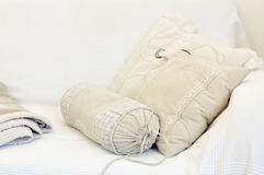 White and yellow pillow on bed Stock Image