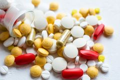 Medications and pills scattered on the white table. View from the top vector illustration