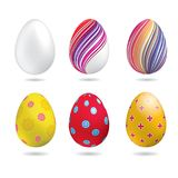 White, yellow, red, striped colorful Easter eggs aon the white background. Set of bright Easter eggs. White, yellow, red, striped colorful Easter eggs aon the Royalty Free Stock Photography