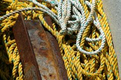 White and yellow rope and a piece of rusty metal Stock Photo