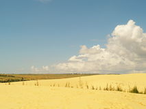 White or yellow sand dune desert and sunlight on hot  summer. And  cloud on blue sky in Vietnam, , beautiful of nature, background and landscape Royalty Free Stock Image