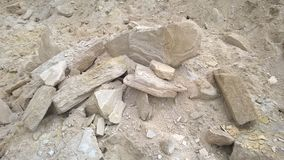 White-yellow sandstone. White and yellow plates cracked sandstone eroded rock Stock Photo