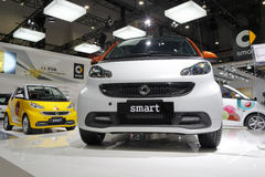 White and yellow smart car Stock Photo