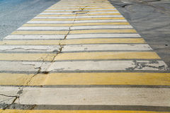 White and yellow stripes on  pedestrian crossing Stock Photo