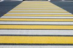 Crosswalk  pedestrian crossing through a street Stock Photos