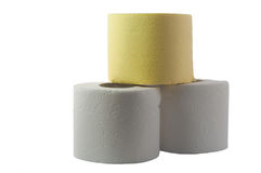 White and yellow toiletpaper on the white backround Royalty Free Stock Images