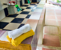 White and yellow towels on sink in bathroom Royalty Free Stock Photo
