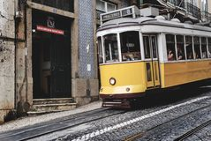 White and Yellow Train With Passenger Royalty Free Stock Photo