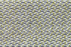 White and yellow vintage fabric with woven texture closeup. Textile macro background Royalty Free Stock Images