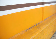White and yellow wall with brown line Stock Photography