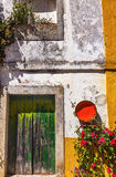 White Yellow Wall Green Door Medieval City Obidos Portugal. White Yellow Wall Green Door Orange Bowl Street 11th Century Medieval Town Obidos Portugal Royalty Free Stock Photo