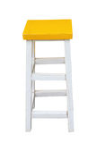 White and yellow wooden stool isolated by hand made clipping pat Stock Photography