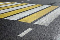 White Yellow Zebra Pedestrian Crossing On The Wet Asphalt Road Stock Photos