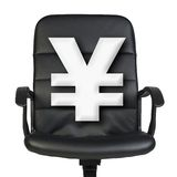 White yen sign stands in chair. Isolated on white. White yen sign stands in leather chair. Isolated on white background Royalty Free Stock Photo