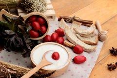 White yogurt and fresh cherry tomatoes Royalty Free Stock Image