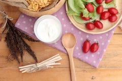 White yogurt and fresh cherry tomatoes with cornflake. Royalty Free Stock Photography
