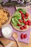 White yogurt and fresh cherry tomatoes with cornflake. Royalty Free Stock Photo