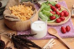 White yogurt and fresh cherry tomatoes with cornflake. Royalty Free Stock Photos