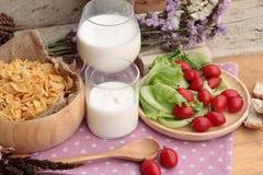 White yogurt and fresh cherry tomatoes with cornflake. Stock Images