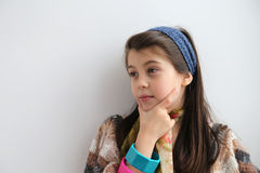 White young girl thinking of new tricks Royalty Free Stock Photos