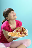 White young instructor evaluating food. Calories from pizza Stock Image