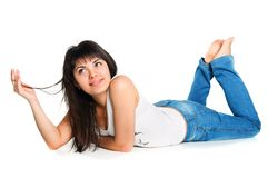 White young woman lying on the floor Stock Images