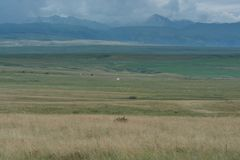 White yurt on the hill. Huge space. Mountains swathed in the clouds. royalty free stock photos