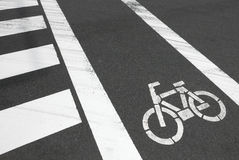 White zebra crossing and bicycle on car road Royalty Free Stock Photo