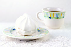 White zephyr and cup of coffee on the lace Royalty Free Stock Photos