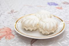White zephyr on a plate. Sweet zephyr on a plate Royalty Free Stock Photos