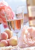 White zinfandel-2. Close up of wine glass, white zinfandel, with flowers Royalty Free Stock Photography
