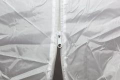 White Zipper. White textile background Royalty Free Stock Photos