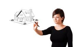 画whiteboard的少妇一个房子 免版税库存照片