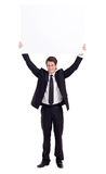 Whiteboard. Young businessman holding a whiteboard Stock Images