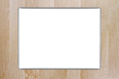 Whiteboard. A blank whiteboard mounted on a wooden wall. Inner and outer clipping paths included for the whiteboard Royalty Free Stock Photography