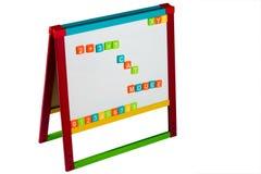 Whiteboard avec la lettre et les numéros Photographie stock libre de droits