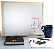 White board for school education of digital circuit design and electronics. A whiteboard with an electronics graph, a printed digital circuit board and a stock photo