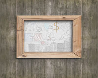 Whiteboard wooden frame with business concepts doodles brown woo. Whiteboard of wooden frame with business concepts doodles on old brown wood wall Royalty Free Stock Photo