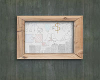 Whiteboard wooden frame with business concepts doodles green woo. Whiteboard of wooden frame with business concepts doodles on old green wood wall Royalty Free Stock Photo
