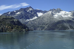 Whitecap Peaks in Prince William Sound. Photo taken aboard ship looking toward rocky coastline in Alaska's Prince William Sound with snowcapped and glaciated royalty free stock photography