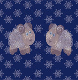 Whitecaps on the snowflakes. Two mirrored lamb on a blue background with falling snowflakes Stock Image