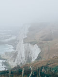 Whitecliffs of Dover. Foggy view of the Whitecliffs of Dover in the UK. Atmospheric coastline. rn Stock Photos