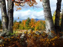 Whiteface Mountain in Fall. View from a country road of mountains and foliage in New Hampshire stock photo