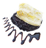 Whitefish with black rice Stock Image