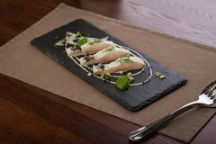 Whitefish fillet. Served on stone plate Stock Images