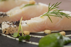 Whitefish fillet. Served on stone plate Stock Photo