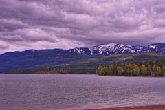 Whitefish lake and Rocky Mountains. A view across the Whitefish Lake with the Rocky Mountains in the distance in Montana Royalty Free Stock Photo