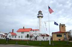 Whitefish Point lighthouse, MI. WHITEFISH POINT, MI - MAY 28:  The lighthouse at Whitefish Point, MI is shown on May 28, 2017. It is the longest working Stock Photography