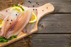 Whitefish Tilapia Fish Raw Fillet royalty free stock photos
